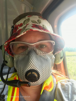 Bambrick wearing an N-95 mask in the helicopter